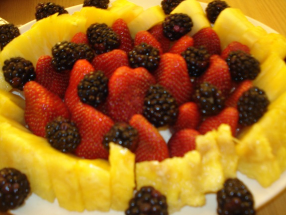 A whole Pineapple, Stawberries, & Blackberries